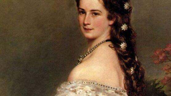 Sissi, então com 28 anos, em traje de gala tendo, no cabelo, flores feitas de diamante pérola, pintura de Winterhalter (1865).